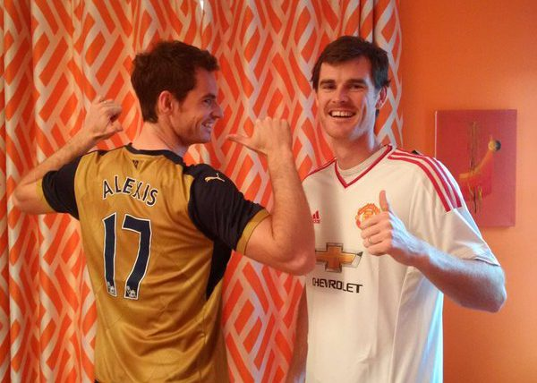 Andy Murray and Jamie Murray showing their football teams