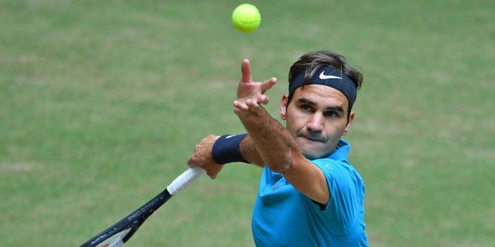 Roger Federer serves