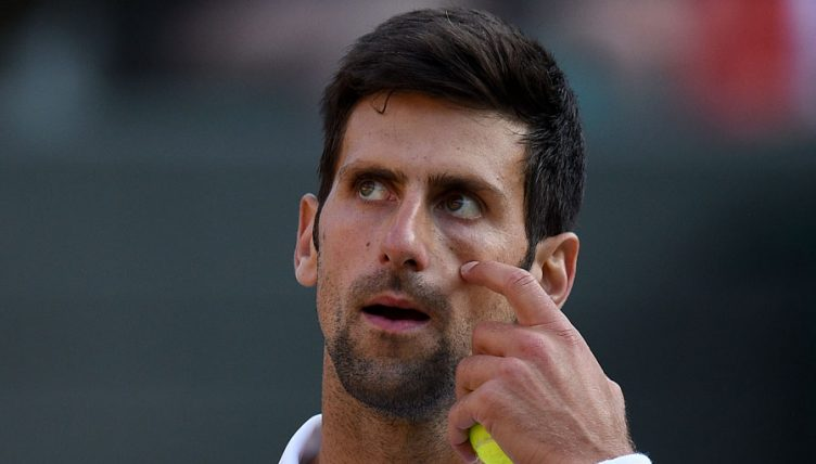 Novak Djokovic looks on