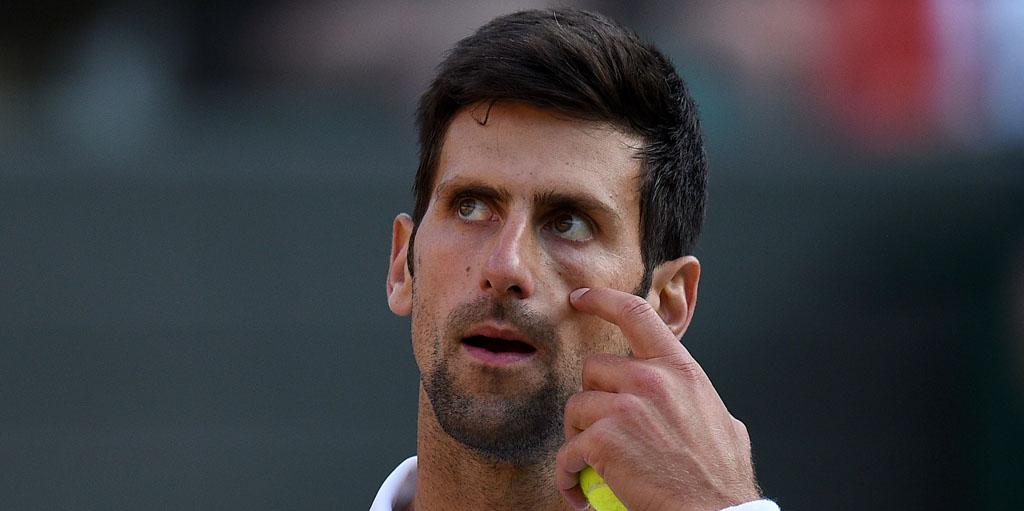 Novak Djokovic looks on