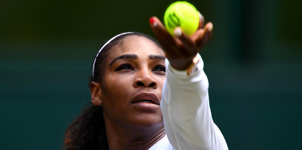 Serena Williams serves