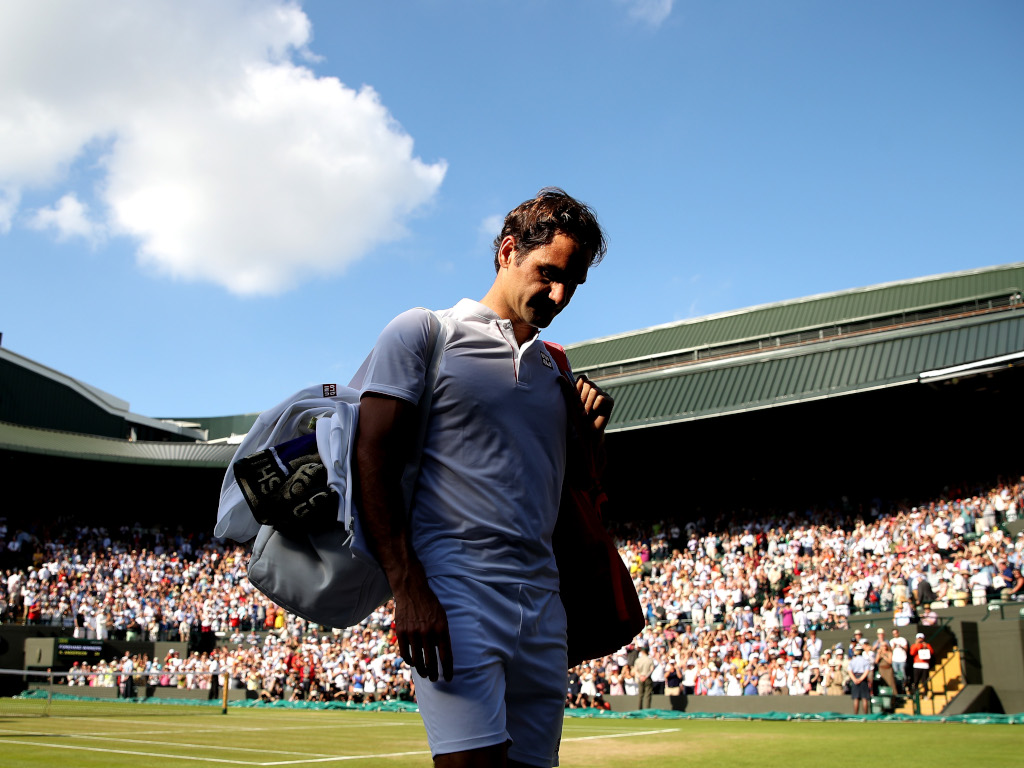 Roger Federer walks of disappointed at Wimbledon