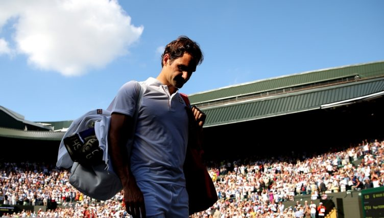 Roger Federer walks off disappointed at Wimbledon