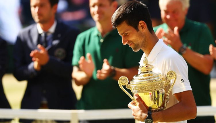 Novak Djokovic with Wimbledon trophy