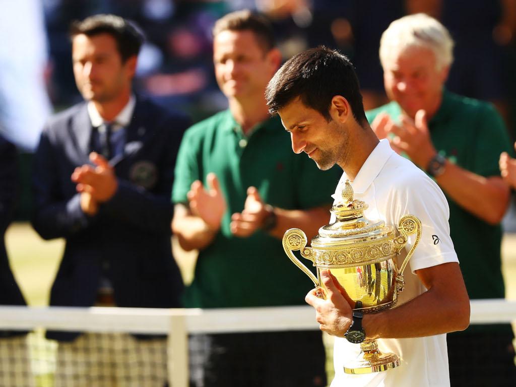Novak Djokovic with Wimbledon trophy