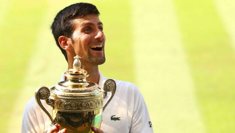 Novak Djokovic celebrates with Wimbledon trophy
