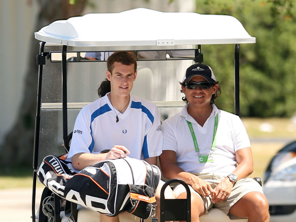 Andy Murray and Patricio Apey in a golf cart