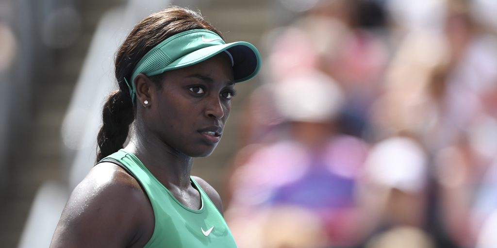 Sloane Stephens looks on