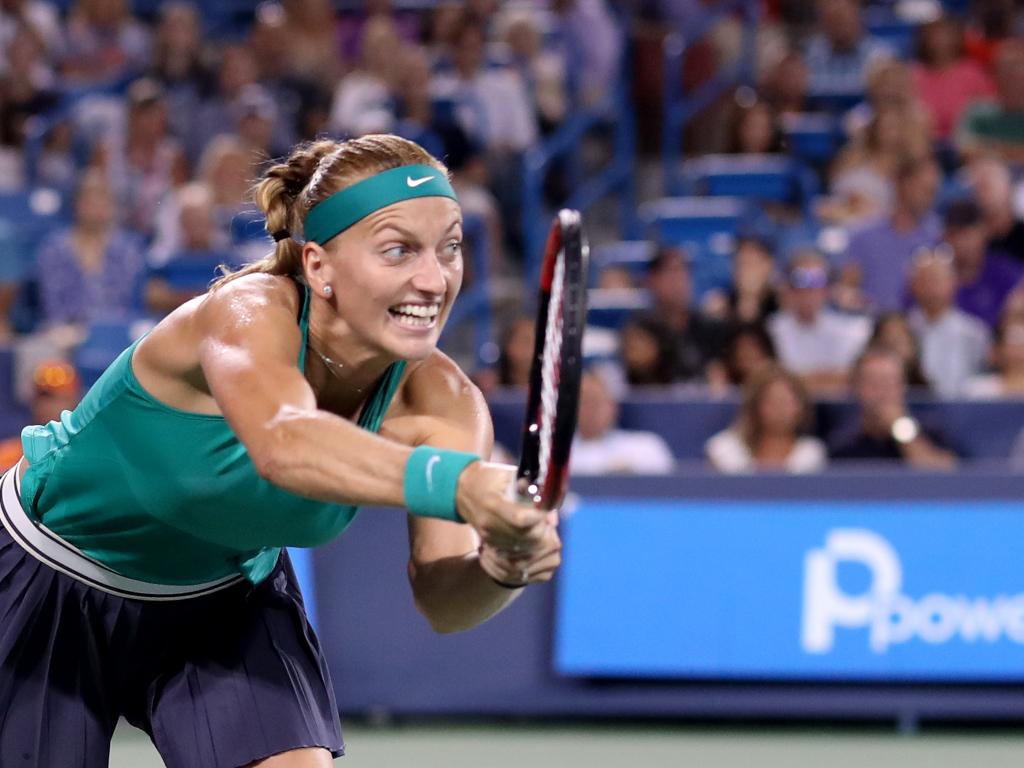 Petra Kvitova reaching for a ball