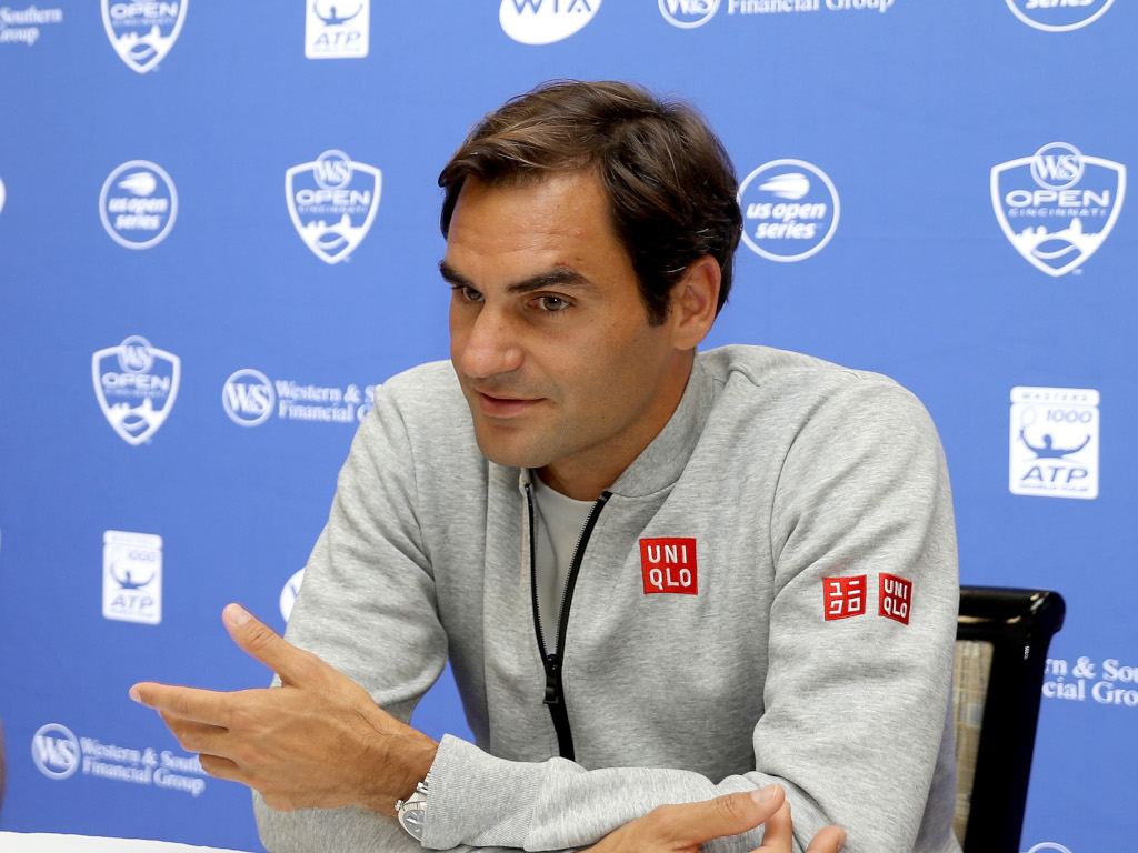 Roger Federer talking to the media