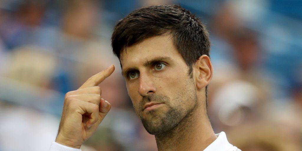 Novak Djokovic pointing to his head