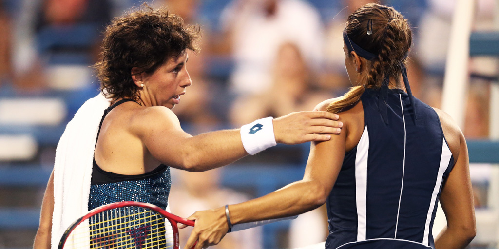 Carla Suarez Navarro comforts Monica Puig at Connecticut Open
