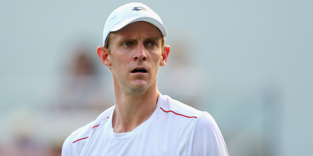 Kevin Anderson looks on