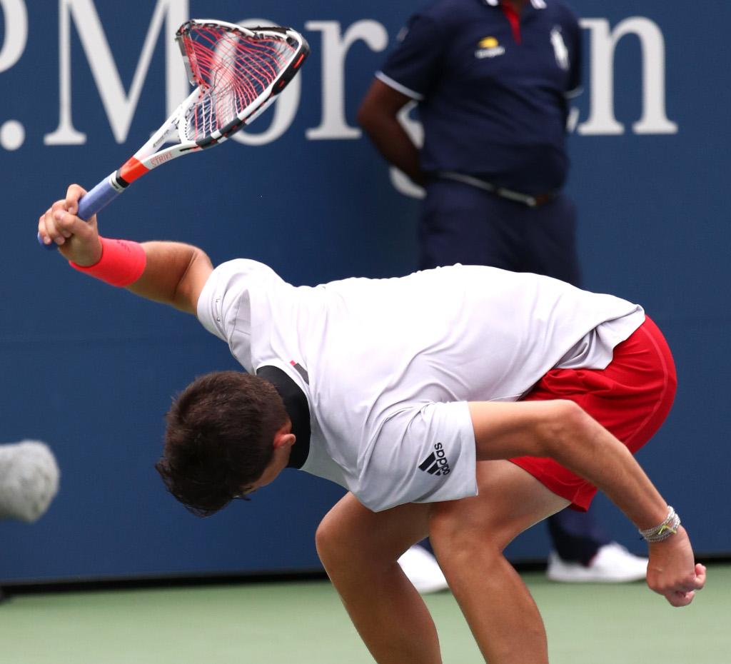Dominic Thiem smashing his racket