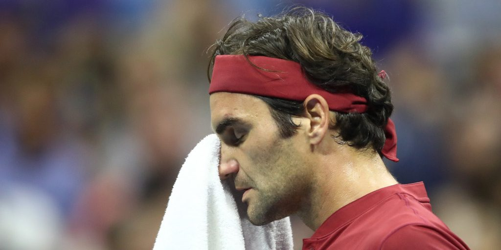 Roger Federer wiping his face