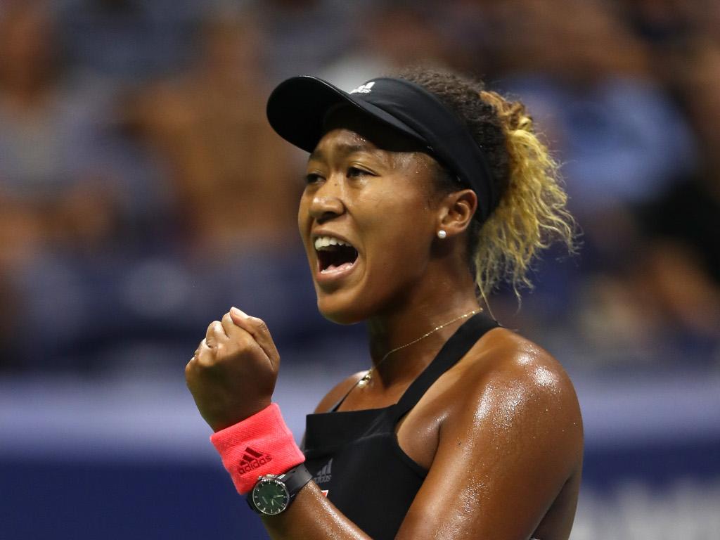 Naomi Osaka celebrates