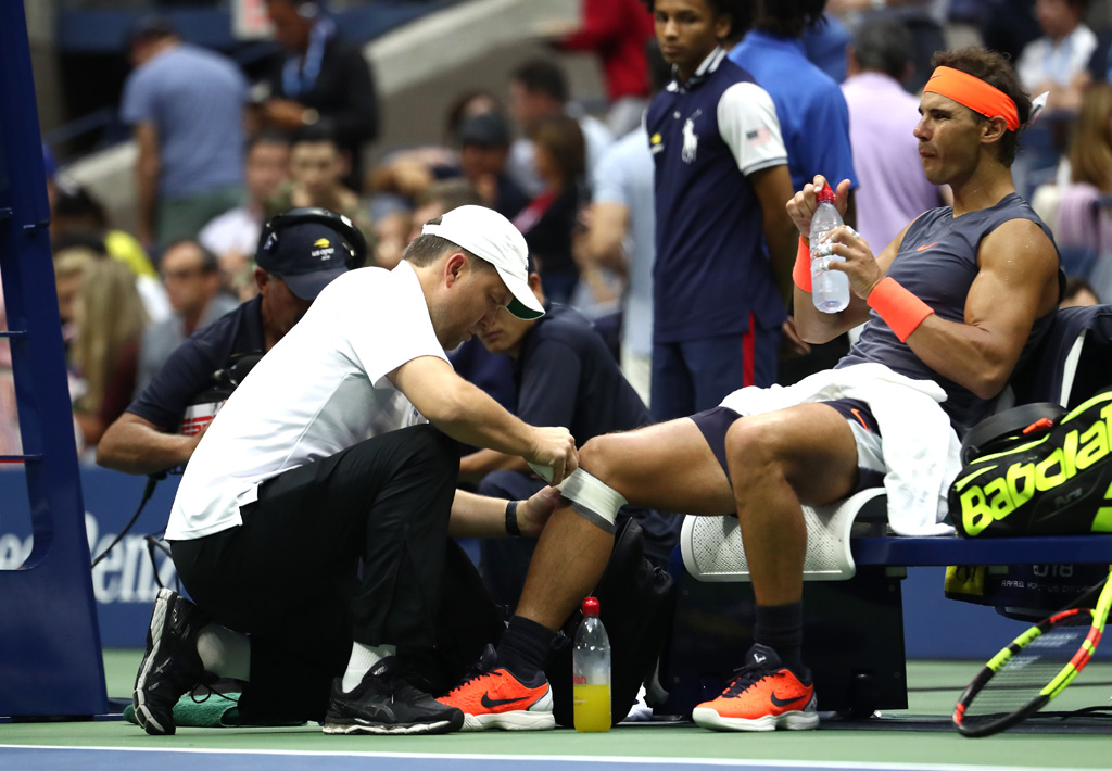 Rafael Nadal receives treatment for injury