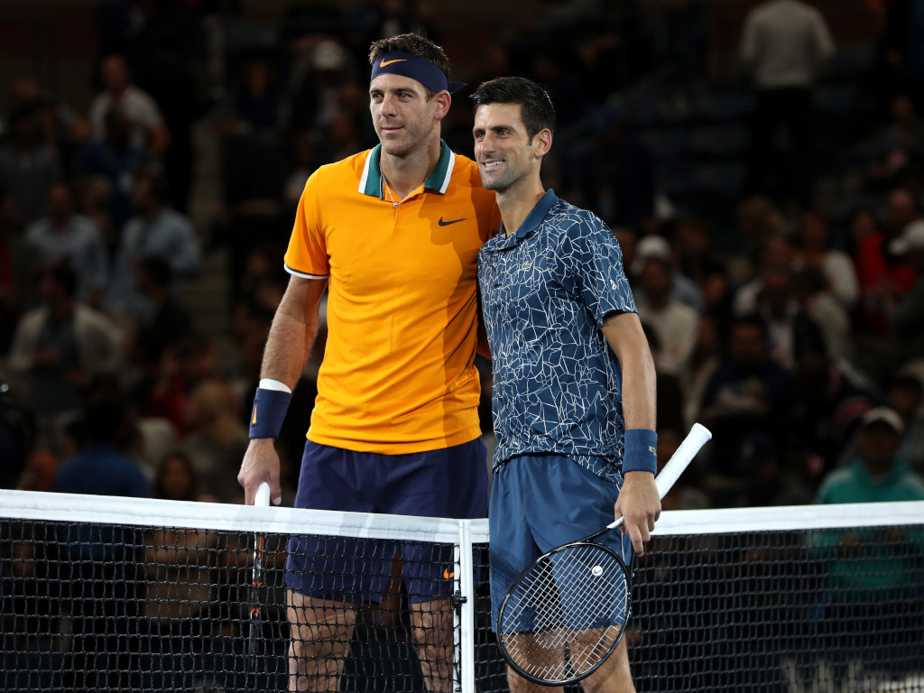 Juan Martin del Potro and Novak Djokovic posing for pictures