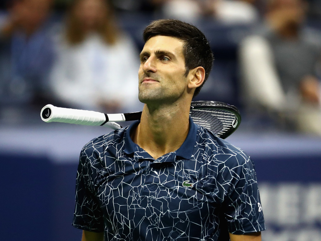 Novak Djokovic racket on the shoulder