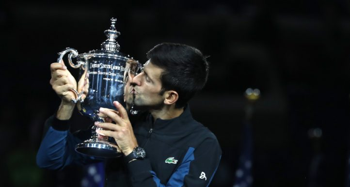 Novak Djokovic kisses US Open trophy top