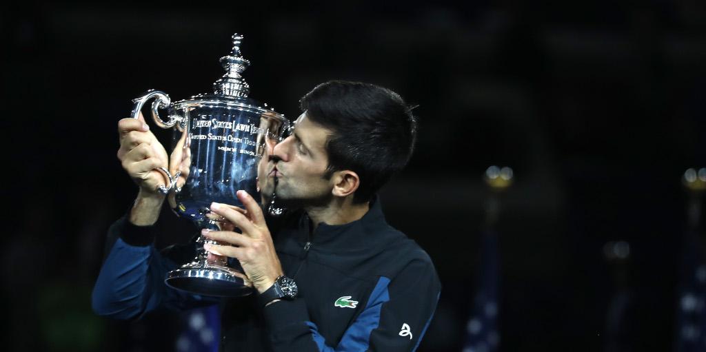 Novak Djokovic kisses US Open trophy top