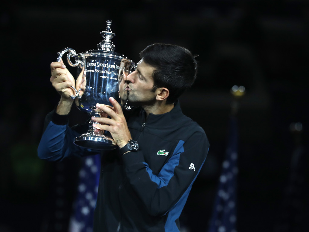 Novak Djokovic kisses US Open trophy