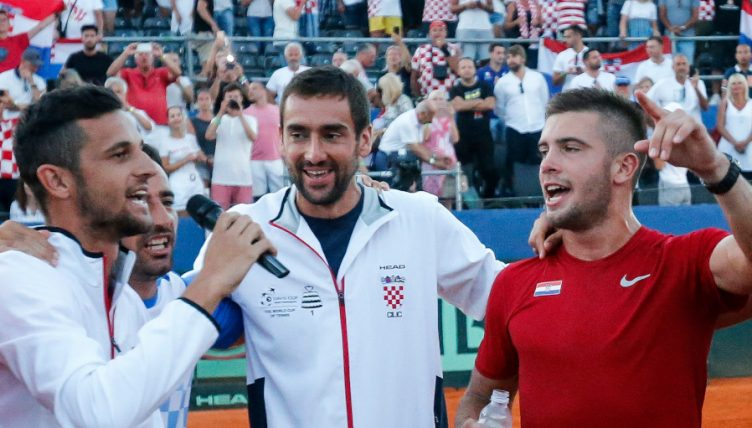 Mate Pavic, Marin Cilic and Borna Coric celebrate Davis Cup win