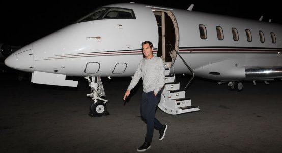 Roger Federer arriving on a private jet