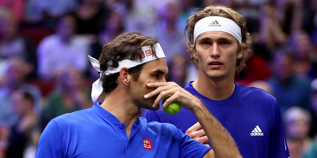 Roger Federer talks to Alexander Zverev