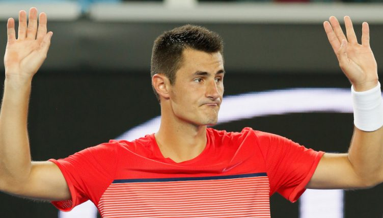 Bernard Tomic arms up