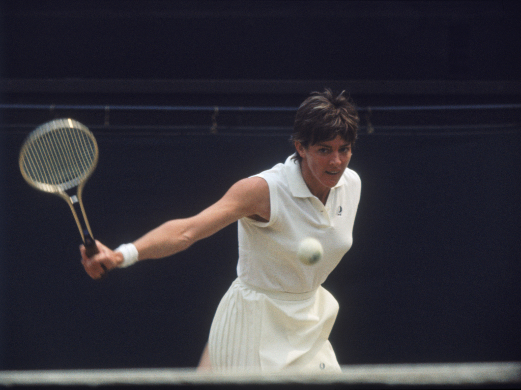 Margaret Court playing with white tennis ball