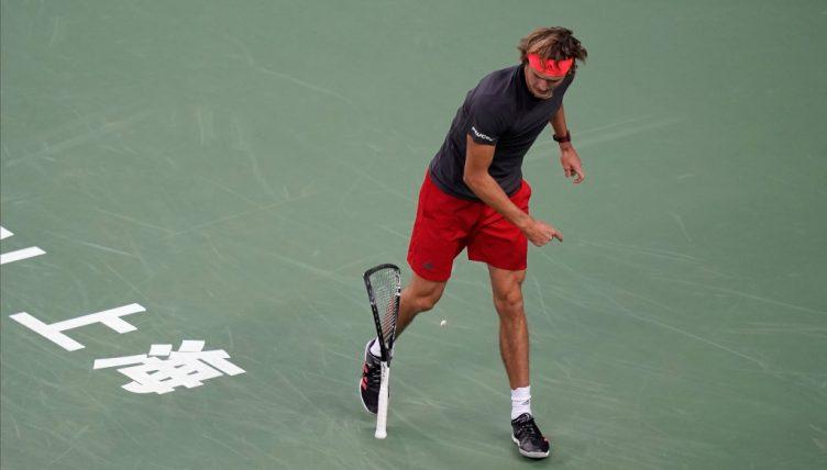 Alexander Zverev smashes his racket