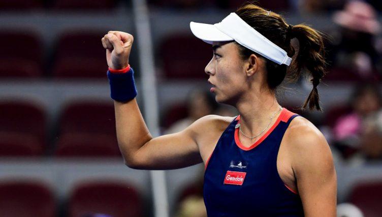 Wang Qiang celebrates