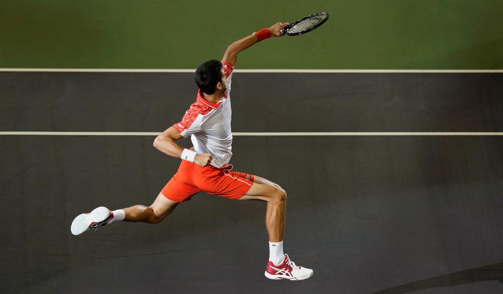 A jumping Novak Djokovic