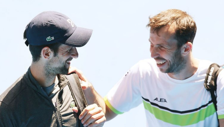 Novak Djokovic and Radek Stepanek share a joke