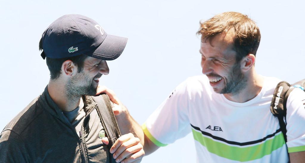 Novak Djokovic and Radek Stepanek share a joke