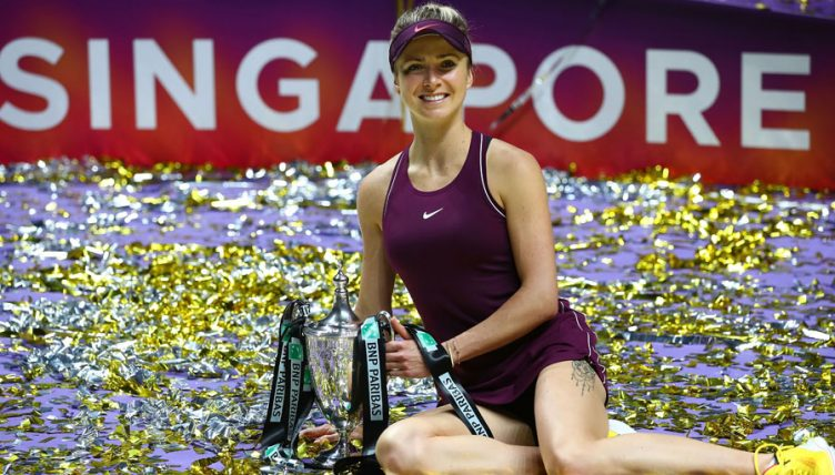 Elina Svitolina celebrates with WTA Finals trophy