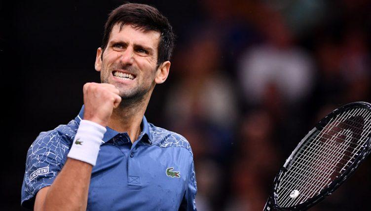 Novak Djokovic celebrates at Paris Masters