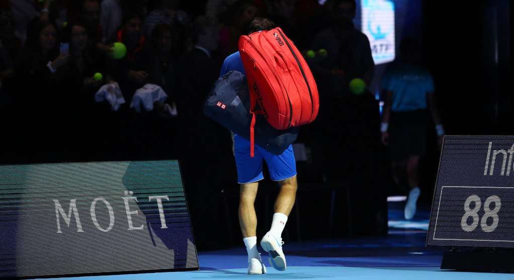 Roger Federer leaves the court