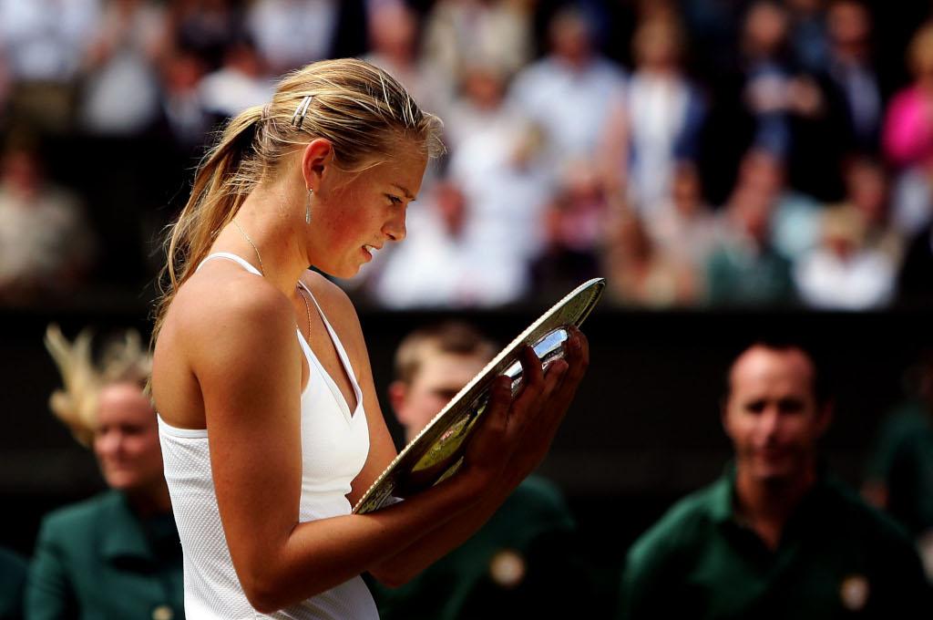 Maria Sharapova with Wimbledon trophy