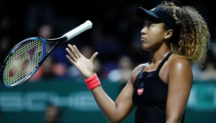 Naomi Osaka drops her racket
