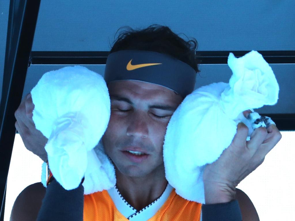 Rafael Nadal using an ice towel