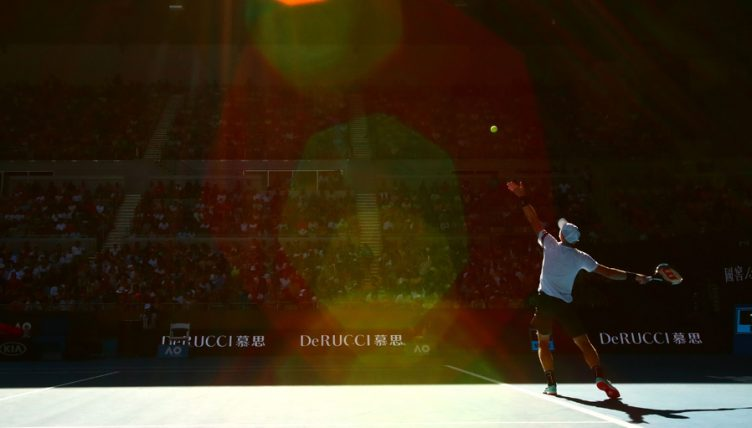 Kyle Edmund serves at Australian Open