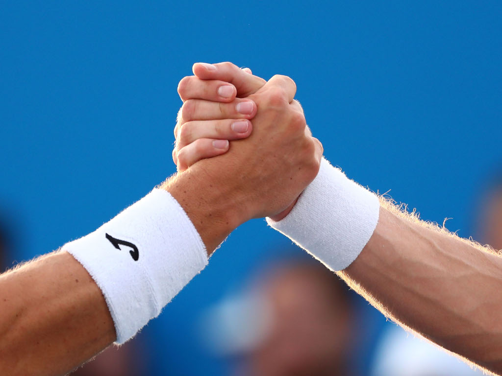 Filip Krajinovic and Marco Cecchinato at the end of their match.