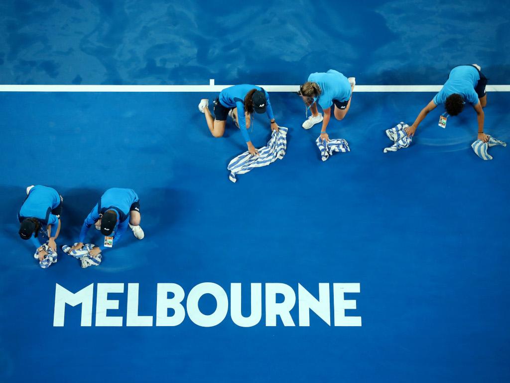 Australian Open rain ball kids mopping up
