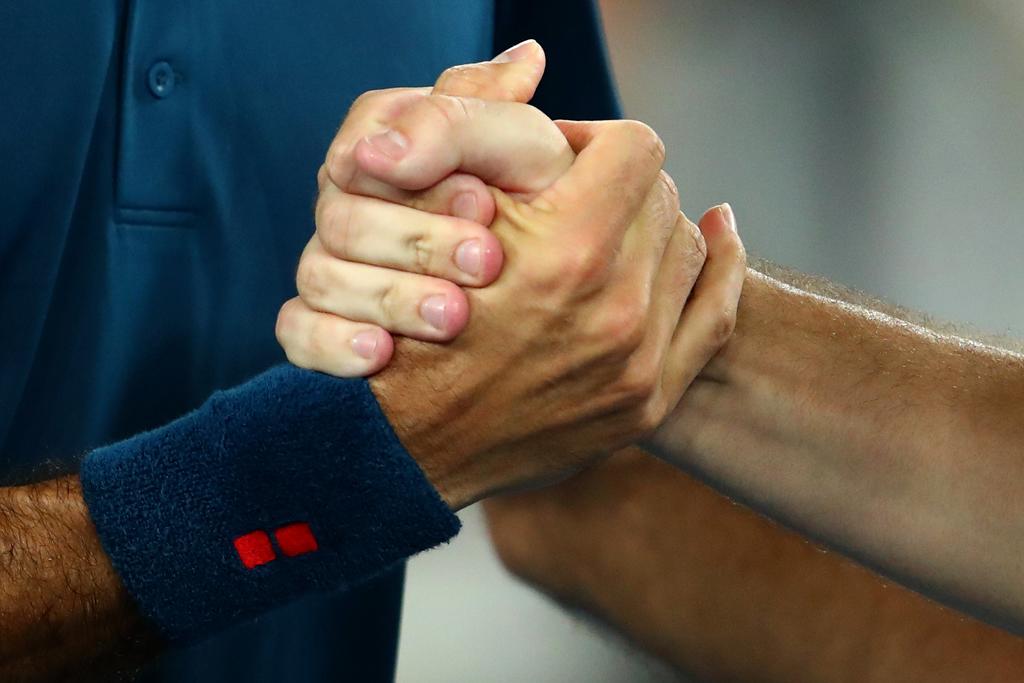 Roger Federer handshake