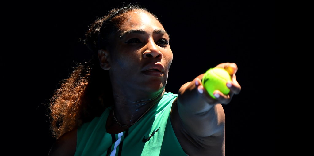 Serena Williams serves at Australian Open