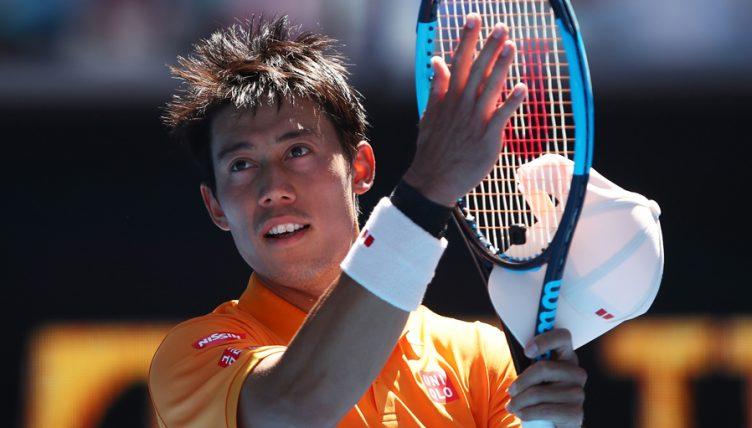 Kei Nishikori salutes crowd
