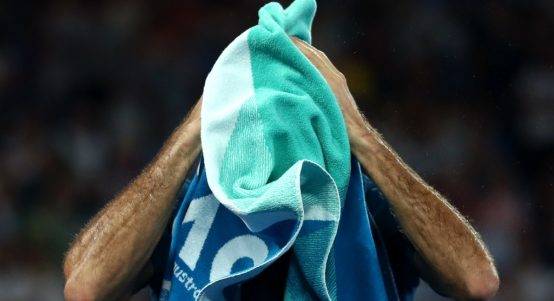 Roger Federer with a towel