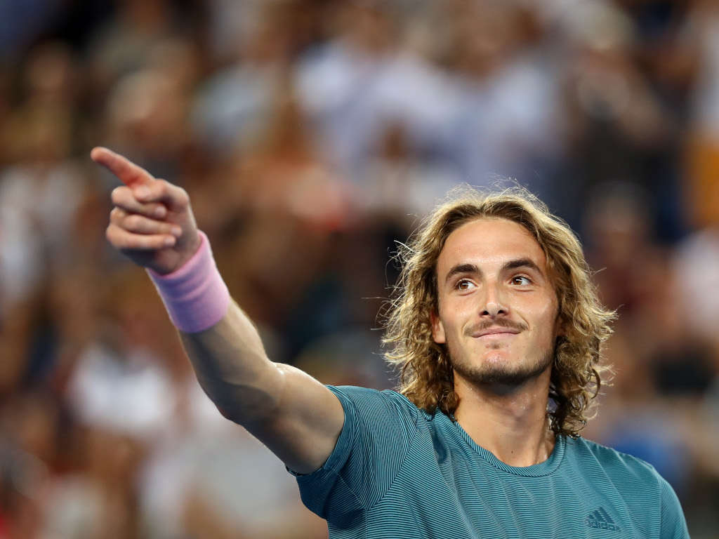 Stefanos Tsitsipas pointing
